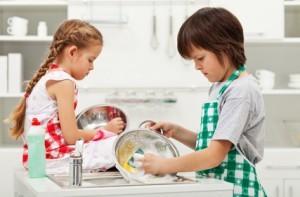 Grumpy kids doing home chores - washing dishes